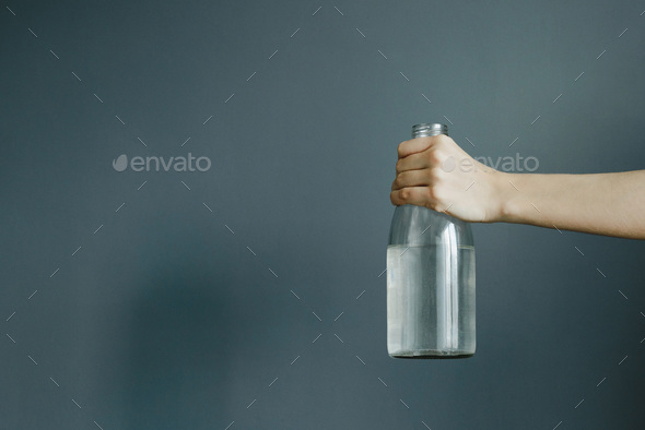 hand holding a bottle of water - Stock Photo - Images