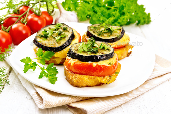 Appetizer of aubergines and cheese on napkin - Stock Photo - Images