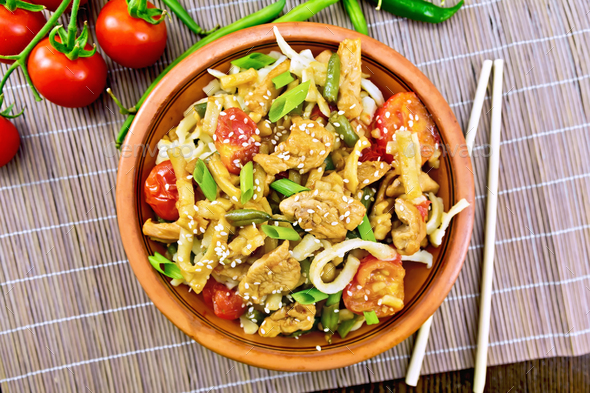 Noodles wok Thai in plate on bamboo top - Stock Photo - Images