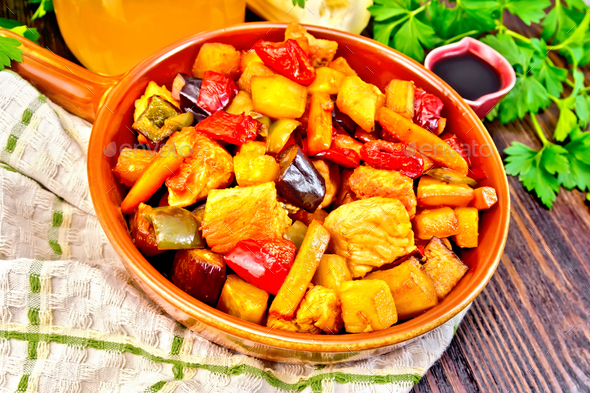 Roast with vegetables and honey in pan on board - Stock Photo - Images