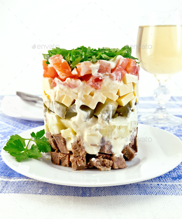 Salad with beef and tomato on tablecloth - Stock Photo - Images