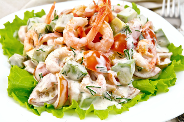 Salad with shrimp and avocado in plate - Stock Photo - Images