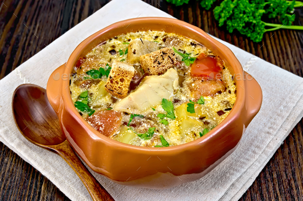 Soup fish with vegetables and cream on board - Stock Photo - Images