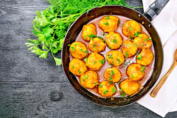 Meatballs in pan on black board top - Stock Photo - Images