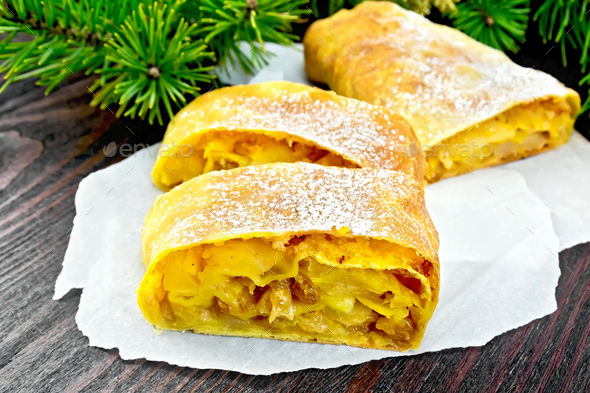 Strudel pumpkin and apple with pine branches on dark board - Stock Photo - Images
