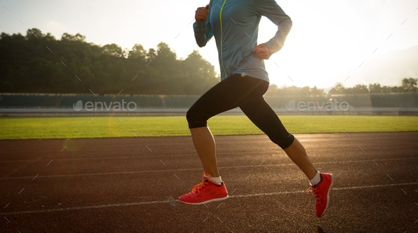 Morning exercise on stadium tracks - Stock Photo - Images