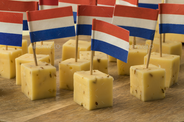 Pieces of traditional Dutch cumin cheese as a snack - Stock Photo - Images