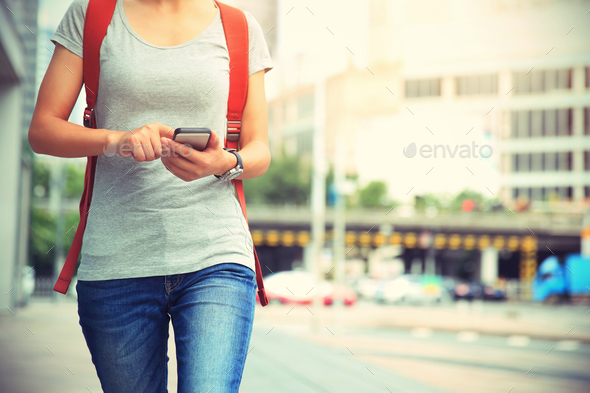 Walking and use mobile phone on street - Stock Photo - Images