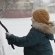 Little Boy Outdoors Cleaning a Snowy Car in Winter Morning - VideoHive Item for Sale