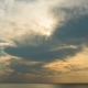 Sunset Through the Rainy Clouds Over Ocean. . - VideoHive Item for Sale