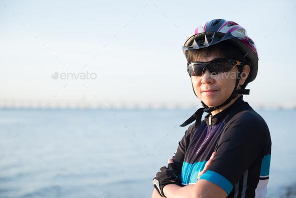 Portrait of senior woman cyclist - Stock Photo - Images