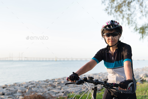 Joyful senior woman riding a bicycle - Stock Photo - Images