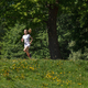 sporty woman running in summer forest - PhotoDune Item for Sale