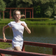 sporty woman running on wooden bridge - PhotoDune Item for Sale