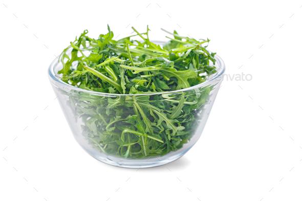 Transparent bowl of fresh arugula - Stock Photo - Images