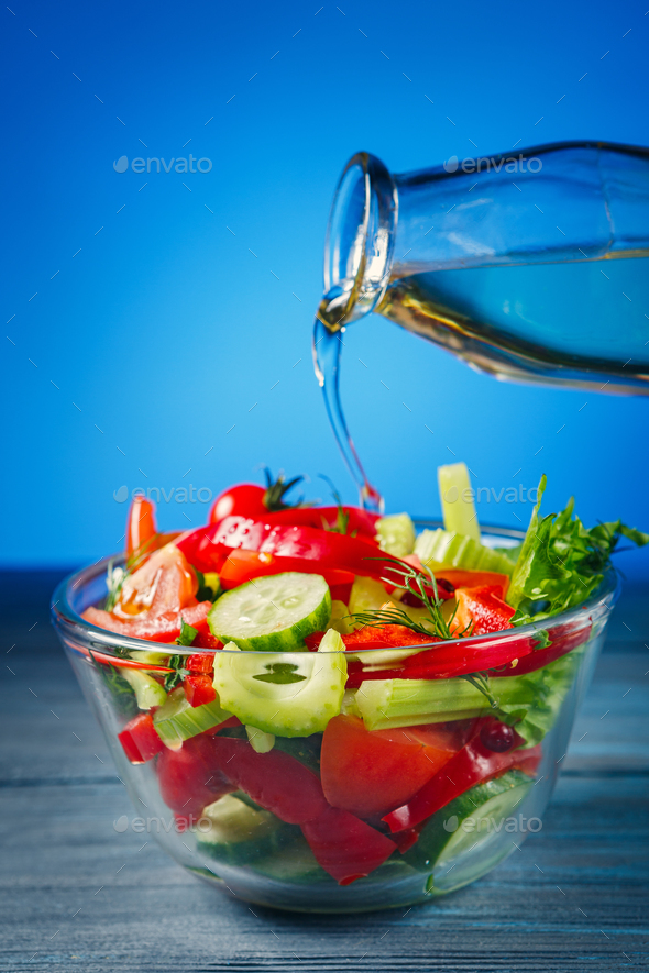 Salad with fresh vegetables and olive oil - Stock Photo - Images