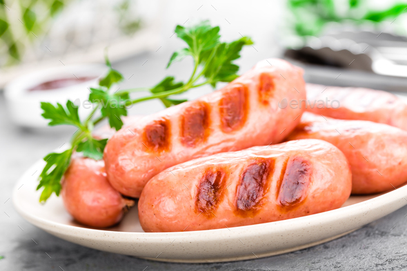 Grilled sausages on plate. BBQ sausages. - Stock Photo - Images