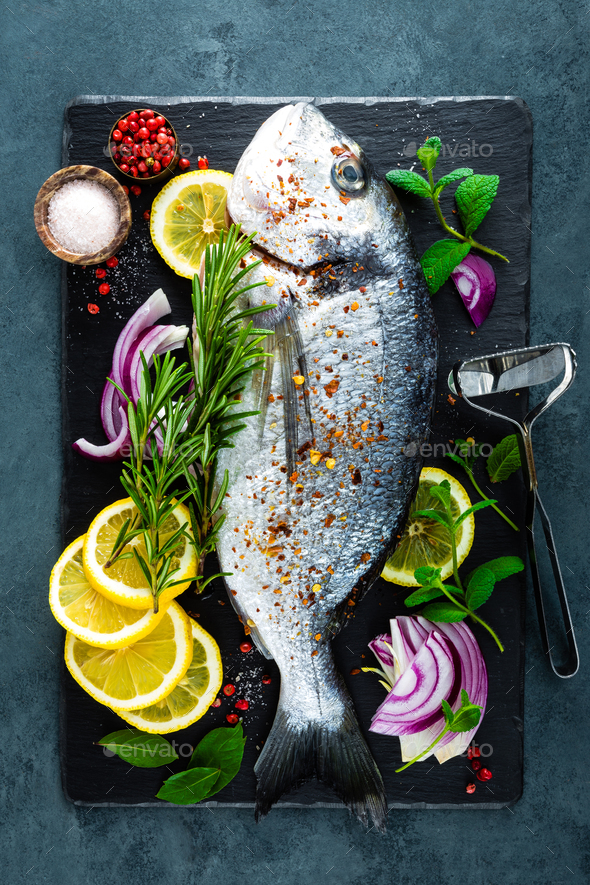 Fresh fish dorado. Raw dorado fish and ingredient for cooking on board. Sea bream - Stock Photo - Images