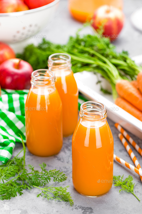 Fresh carrot and apple juice on white background. Carrot and apple juice - Stock Photo - Images