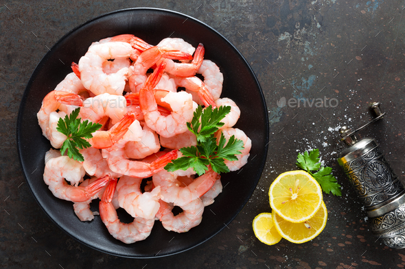 Prawns on plate. Shrimps, prawns. Seafood. Top view. Dark background - Stock Photo - Images