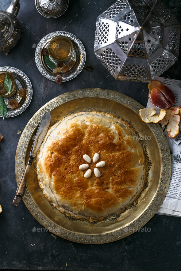 Phyllo pastry pie with chicken and spices. Arabian cuisine. - Stock Photo - Images