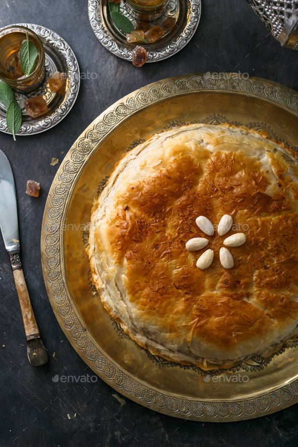 Top view of bastilla, layered moroccan pie with chicken - Stock Photo - Images