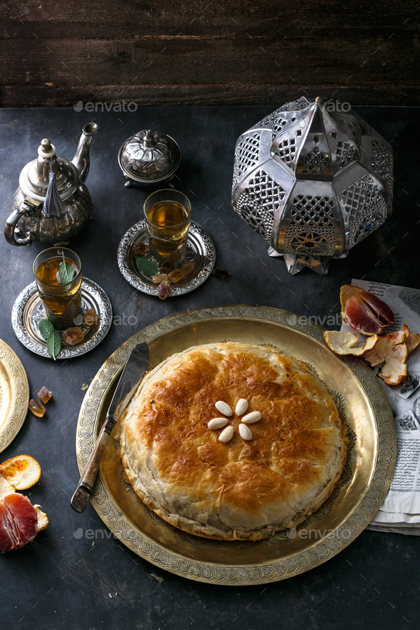 Traditional Moroccan pie pastilla with mint tea - Stock Photo - Images