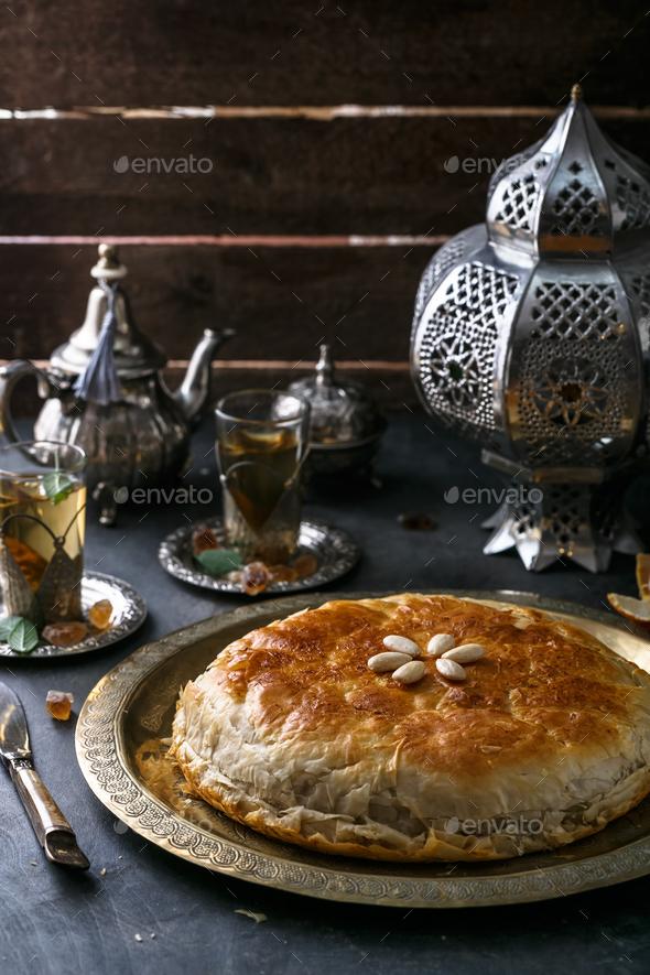 Moroccan chicken bastilla on copper plate, close view - Stock Photo - Images