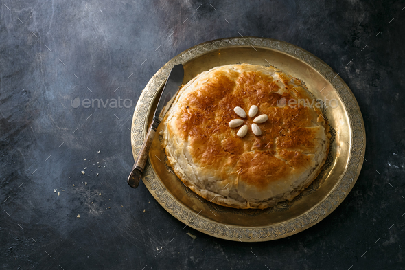 Moroccan bastilla on copper palte, space for wording - Stock Photo - Images