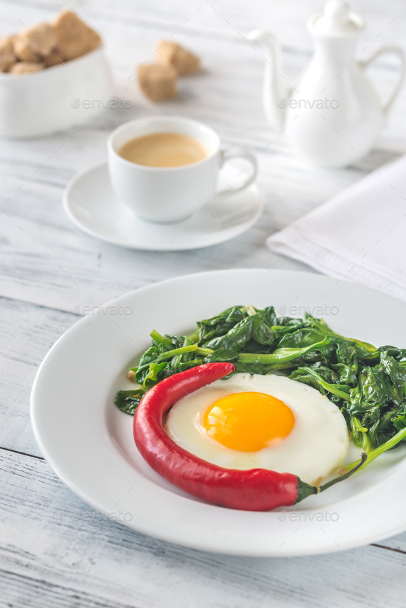 Fried egg with spinach - Stock Photo - Images