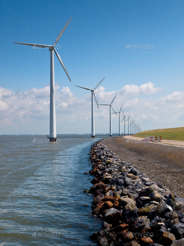 Row of wind turbines along the coast - Stock Photo - Images