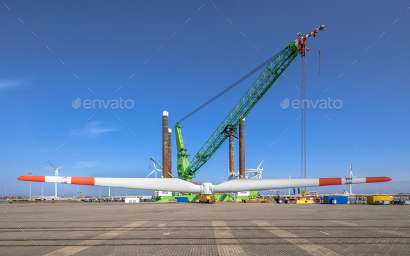Offshore wind energy supply vessel loading rotor - Stock Photo - Images
