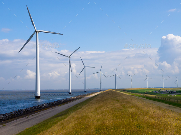 Row of windturbines along motorway - Stock Photo - Images