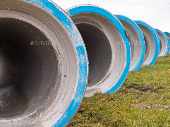 Row of concrete construction pipes - Stock Photo - Images
