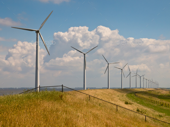 Row of wind turbines with fence - Stock Photo - Images