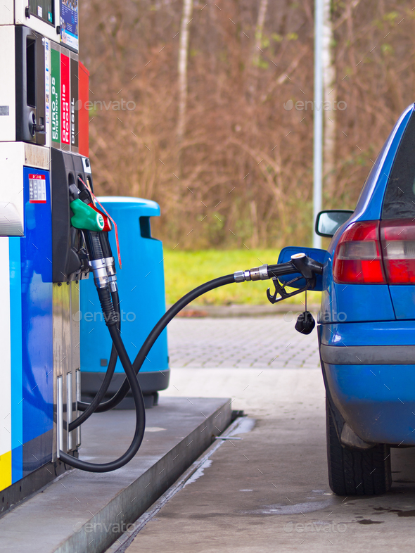 Blue car at gas station - Stock Photo - Images