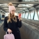 Young Woman Using Smartphone in Airport - VideoHive Item for Sale