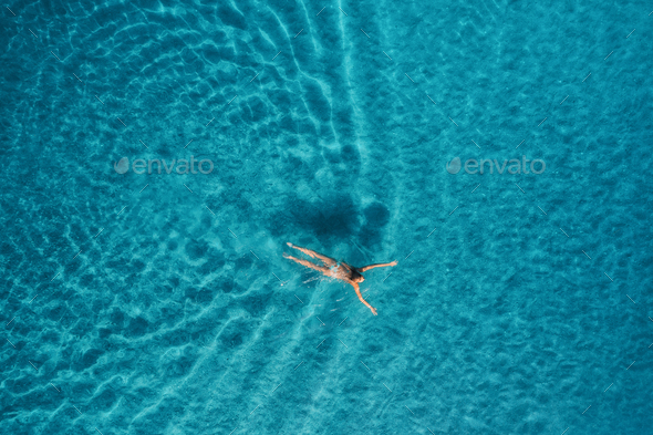 Aerial view of swimming woman in mediterranean sea - Stock Photo - Images