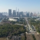 Green Park and Shanghai Downtown at Sunny Day. China. Aerial View. Drone Is Flying Forward and Up - VideoHive Item for Sale