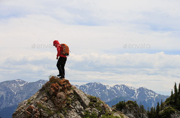Climbing up to the peak - Stock Photo - Images
