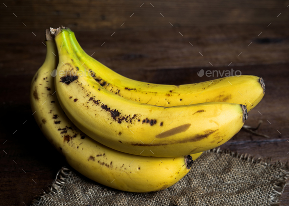 bananas on canvas and wooden board - Stock Photo - Images