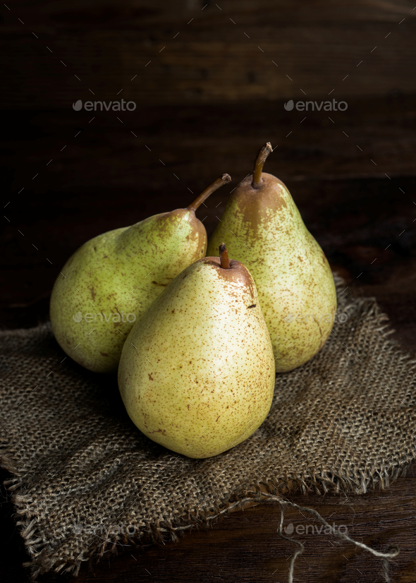 pears on canvas and wooden board - Stock Photo - Images