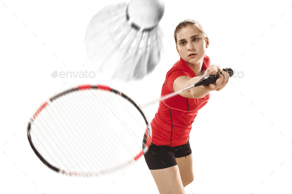 Young woman playing badminton over white background - Stock Photo - Images