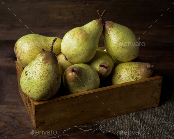 pears in box on canvas and wooden board - Stock Photo - Images
