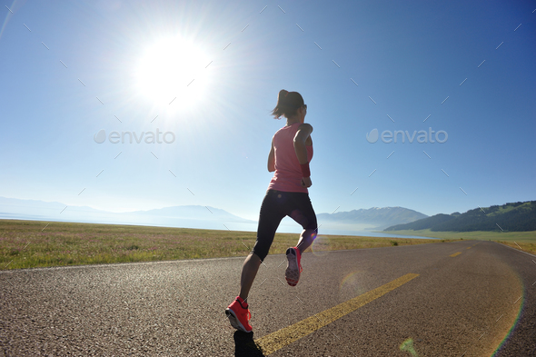Runner running on highway - Stock Photo - Images