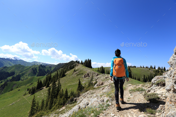 Hiking on mountain top trail - Stock Photo - Images