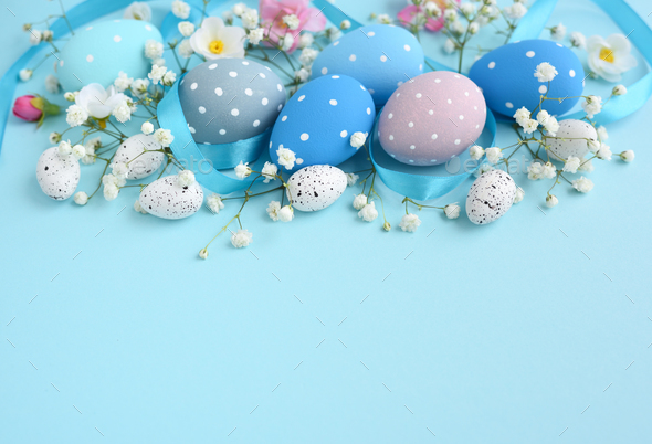 Easter eggs on a blue background. Festive easter background - Stock Photo - Images