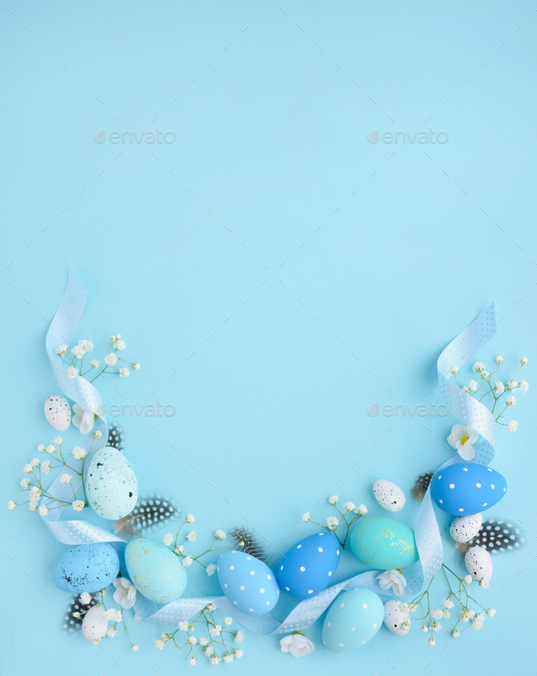Easter eggs on a blue background with empty space. Easter card. - Stock Photo - Images