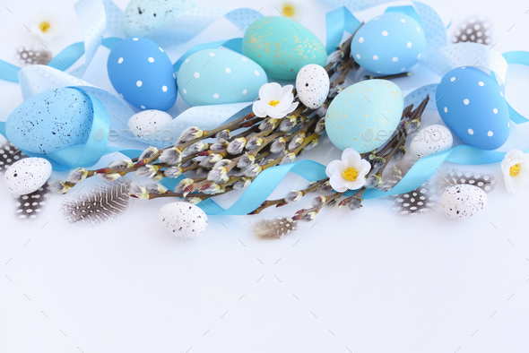 Easter eggs and willow branches on white background. Easter card - Stock Photo - Images