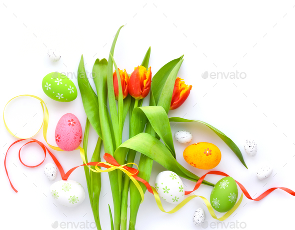 Easter eggs with tulips on white background. Top view. - Stock Photo - Images